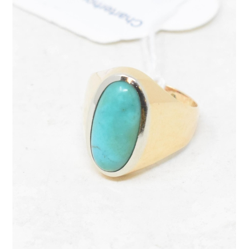 380 - A gold and turquoise dress ring...