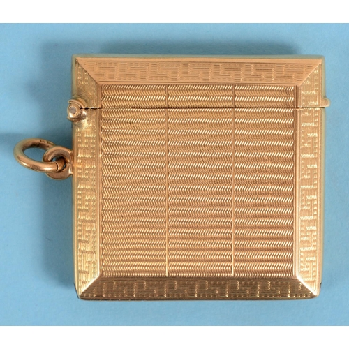 383 - An 18ct gold vesta case, with engine turned decoration, approx. 35.1 g See illustration...