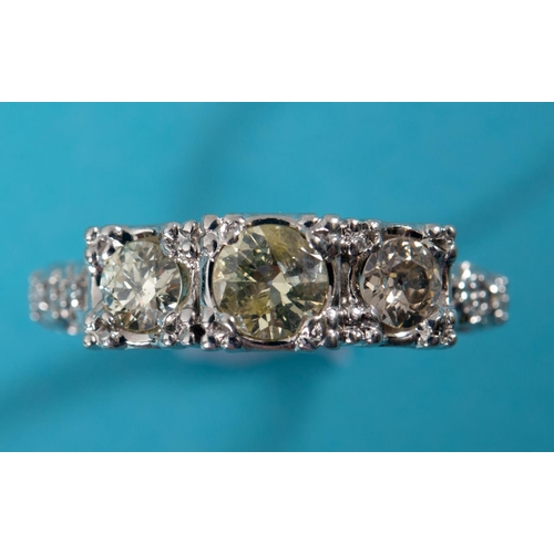 401 - A 14ct white gold and three stone diamond ring, approx. ring size S See inside front cover colour il...
