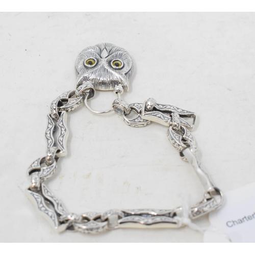 404 - A silver owl padlock bracelet...
