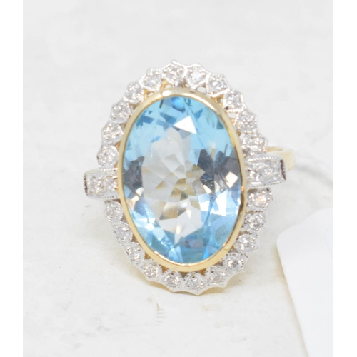 407 - A 9ct gold, blue topaz and diamond ring, approx. ring size M...