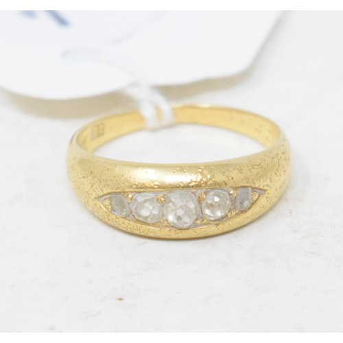 411 - An 18ct gold and five stone diamond ring, approx. ring size M...