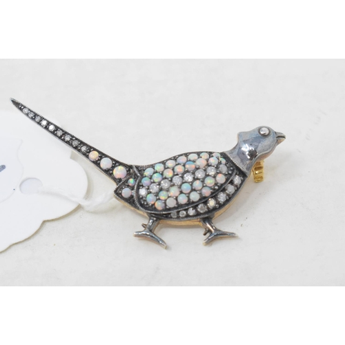 433 - A 9ct gold and silver opal and diamond pheasant brooch...