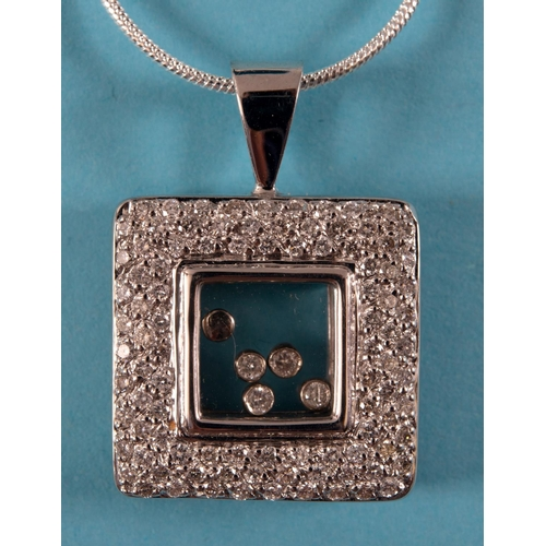 437 - An 18ct white gold and diamond Chopard style pendant on chain See illustration...