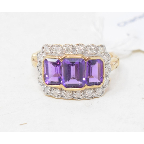 444 - A 9ct gold and three emerald cut amethyst and diamond ring, approx. ring size O...