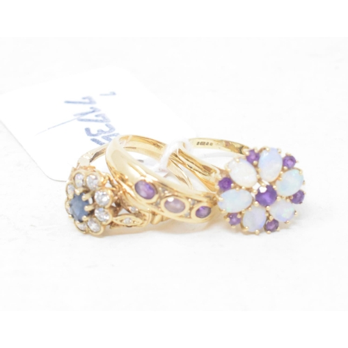 457 - A 9ct gold, opal and amethyst ring, approx. ring size W, and two other 9ct gold rings (3)...