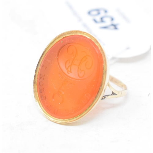 459 - A 9ct gold and intaglio cut carnelian signet ring, approx. ring size O½...