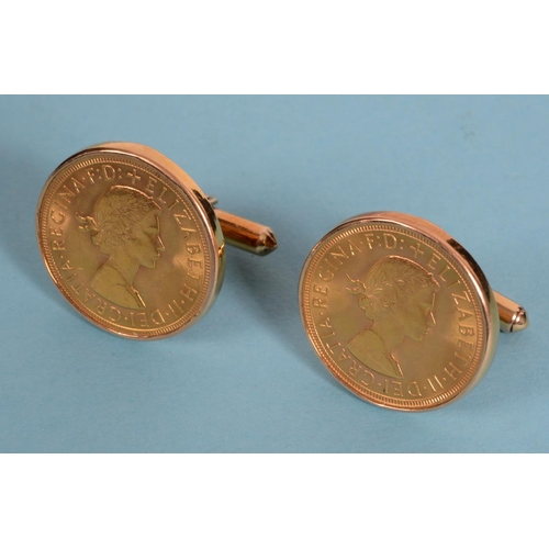 461 - A pair of Queen Elizabeth II sovereign cufflinks, 1967, in 14ct gold mounts (2)  See illustration...