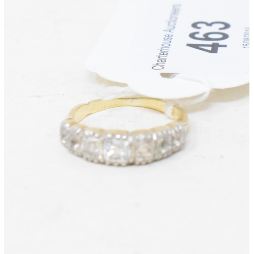 463 - A seven stone diamond half hoop ring, in a yellow coloured metal mount, apparently unmarked, approx....