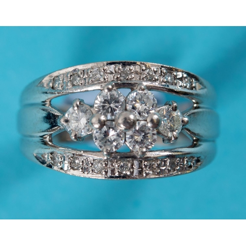 471 - A white gold ring, with diamonds in a pierced setting, approx. ring size K See illustration...