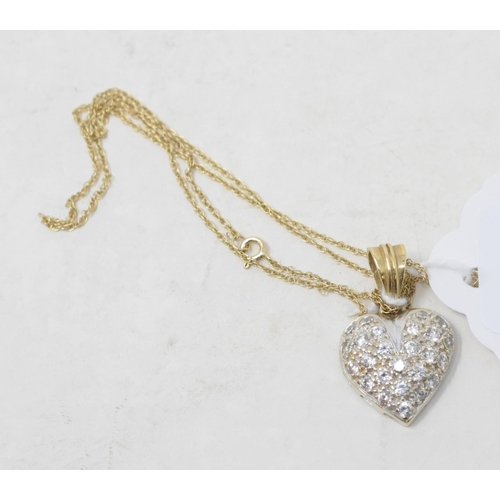 493 - A 9ct yellow gold and diamond heart shaped pendant, on a chain...