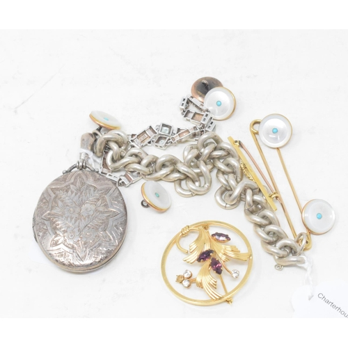 494 - An oval silver locket, six 9ct gold mounted dress studs, and other items...