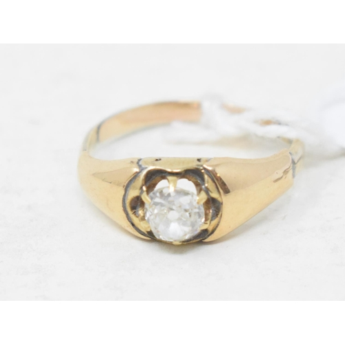503 - A diamond solitaire ring, in a yellow coloured metal mount, approx. ring size M½...