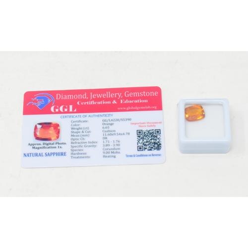 506 - A cushion cut orange natural sapphire, 6.65ct, with GGL certificate...