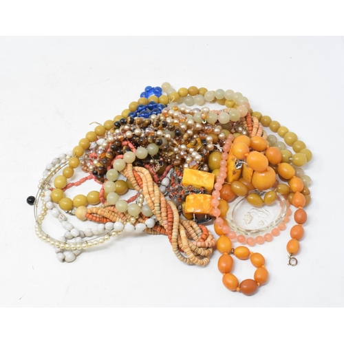 515 - Assorted costume jewellery, silver backed dressing table items, and a satinwood box, 41 cm wide...