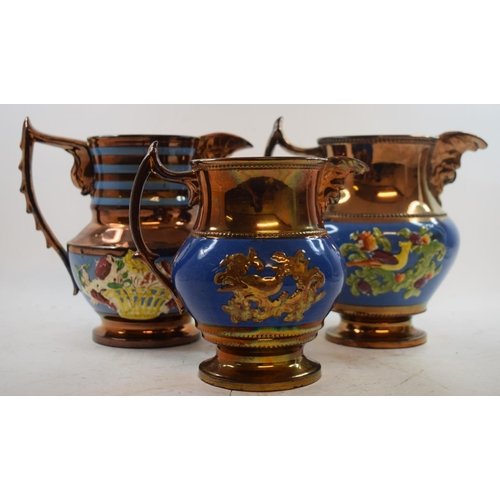552 - A collection of Victorian copper lustre jugs (box)...