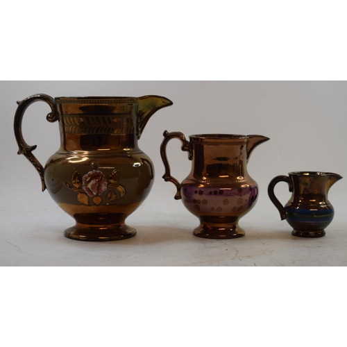 556 - A collection of Victorian copper lustre jugs, and other similar items (box)...