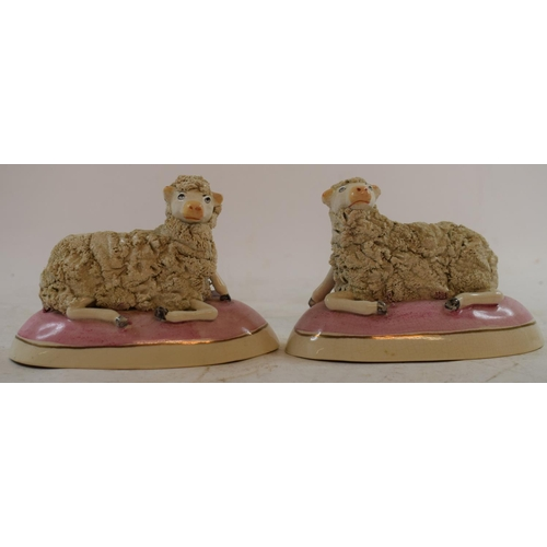 563 - A pair of Staffordshire pottery sheep, 9 cm high, a pair of vases and a pair of stools (6)...