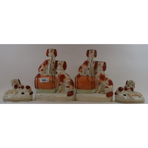 565 - A pair of Staffordshire pottery pen holders, in the form of spaniels with dead rams, 9.5 cm high, an...