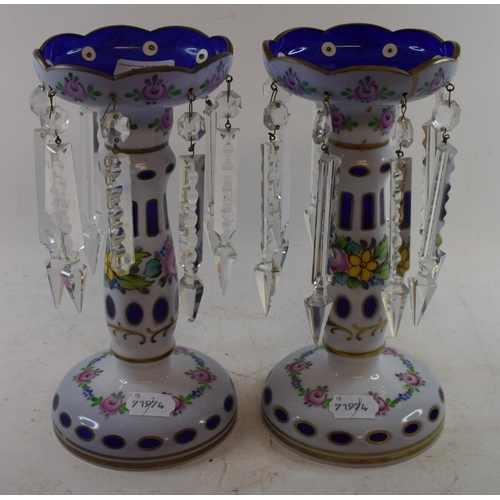 581 - A pair of cased glass lustres, with floral decoration, 26 cm high (2)...