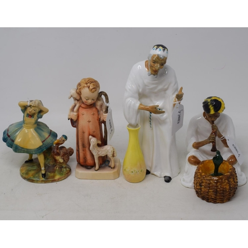 592 - An early Wade group, Alice 1, 12.5 cm high, a Hummel group, the young shepherd, and two Arthur Bowke...