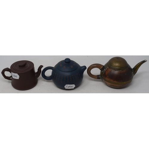 596 - A Yixing pottery teapot, decorated calligraphy, 9 cm high, and two others (3)...