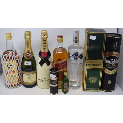 613 - A bottle of Moet & Chandon champagne, NV, two other bottles of champagne, a bottle of Johnnie Walker...