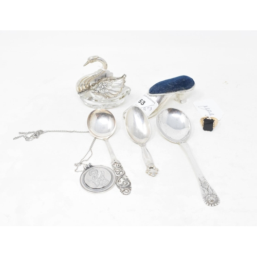 63 - A silver pincushion, in the form of a shoe, marks rubbed, three silver spoons, a silver medallion, a...