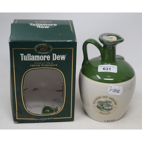 631 - A bottle of Tullamore Dew whiskey, in a ceramic bottle, with original carton...