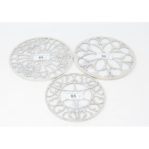 65 - A silver mounted glass stand, Birmingham 1930, 15.5 cm diameter, and two others similar (3)...