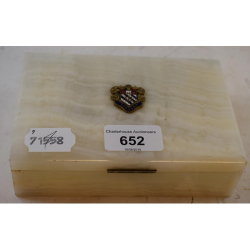 652 - A white marble box, applied a Torquay Town crest, 15 cm wide...