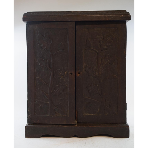 654 - A 19th century carved oak table cabinet, with a fitted interior, 31 cm wide...