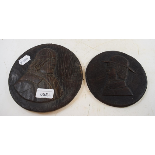 655 - An oak roundel, carved a figure, 18.5 cm diameter, and another similar (2)...