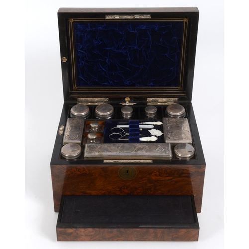 66 - A Victorian dressing case, veneered in burr walnut, the glass fittings with silver plated mounts, 31...