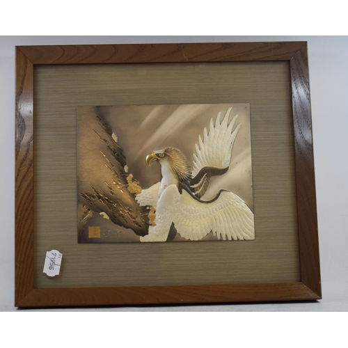 683 - A mixed metal plaque, decorated an eagle, signed, 17 cm wide, and another (2)...
