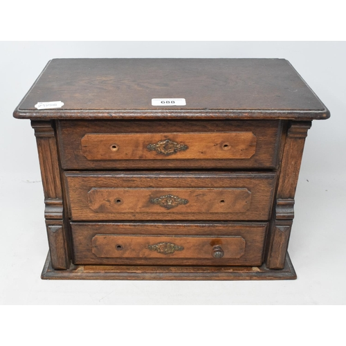 688 - An oak table top chest of three drawers, 35.5 cm wide...