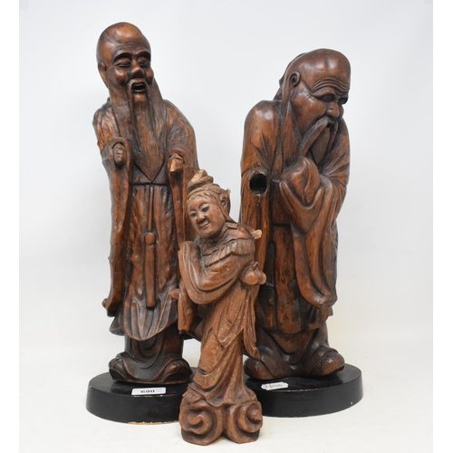 690 - A Chinese carved rootwood figure, 46 cm high, and two others (3)...