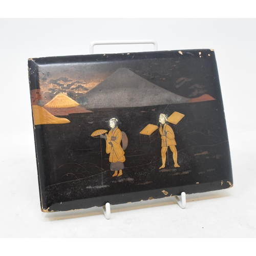 696 - A Japanese lacquered photograph album, decorated figures in a landscape, 20 cm wide...