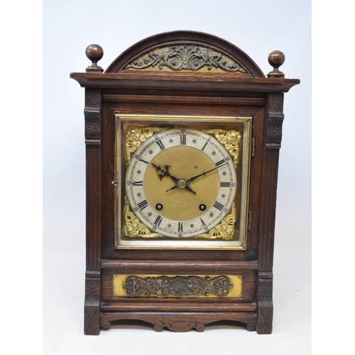 699 - An Edwardian mantel clock, the 17 cm square brass dial signed J W Benson, Ludgate Hill, London, with...