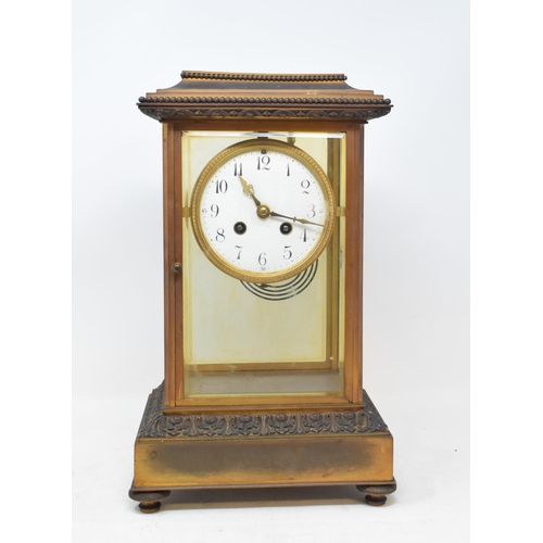 700 - A four glass clock, the 10 cm enamel dial with Arabic numerals, fitted an eight day movement, with a...