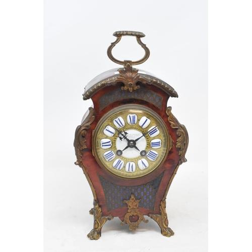 706 - A Louis XVI style mantel clock, the 8 cm diameter dial signed Goldsmiths Company, Regent Street, Lon...