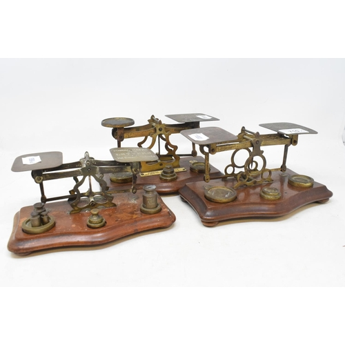 710 - Three sets of postal scales, a silver backed dressing table set, cased, and a tripod stand (5)...