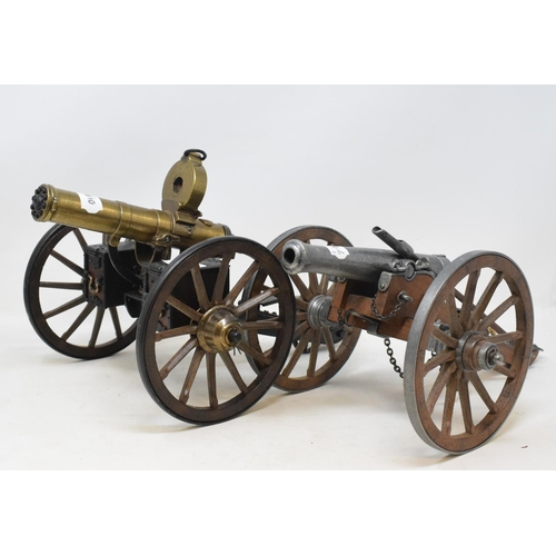 711 - A model 1883 Gatling gun, Hartford, Conn maker's plaque to carriage, 36 cm, another model gun and th...