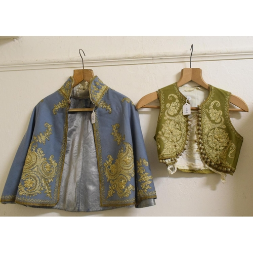 736 - An 18th century style childs jacket, with gold coloured metal embroidery, and two similar waistcoats...