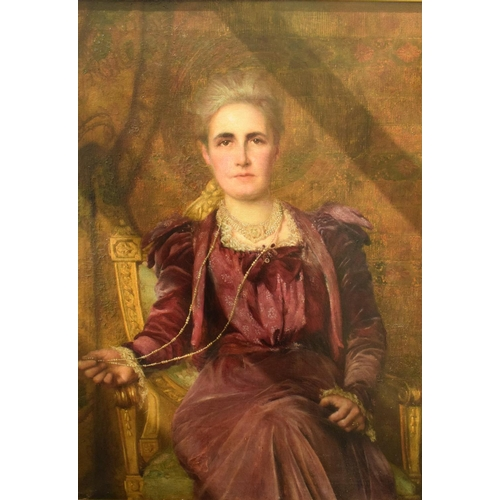 767 - English school, early 20th century, a portrait of a seated lady wearing a purple velvet dress and a ...