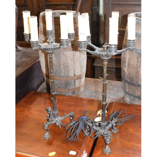 783 - A pair of late 19th century bronze five light candelabra, adapted for electricity, on lioness head l...