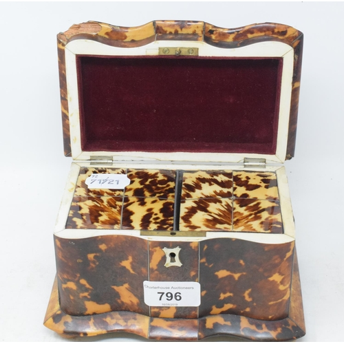 796 - An early Victorian tea caddy, veneered in tortoiseshell, with a shaped front, on bun feet, slight lo...