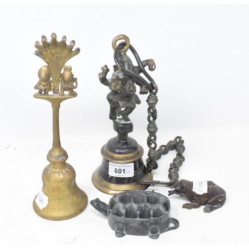 801 - An Indian bell and chain, surmounted by Ganesh, 9 cm diameter, another, a metal tortoise and a metal...
