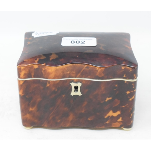 802 - A tortoiseshell tea caddy, of shaped rectangular form, 12.5 cm wide...