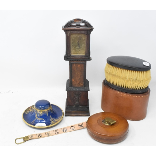 805 - A miniature longcase clock, in an inlaid case, 31 cm high, a Carlton Ware inkstand, a leather covere...
